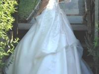 BRIDAL GOWN This beautiful full A-line gown features a