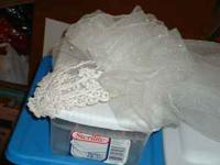 Used bridal veil and boquet. $25.00 Text or call