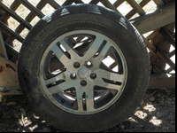 Two Bridgestone Turan EL42 235/65B17 tires. Like new
