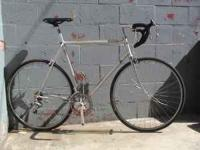 58 cm frame. New tubes/tires, bars, brakes and has