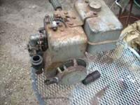 has tapered shaft horizontal old style carb. gas tank