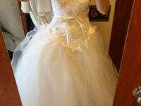 Stunning White Strapless Wedding event Dress. It says