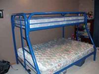 Bright blue metal frame bunk bed w/single mattress on
