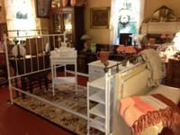 We have for sale an attractive white iron bed,