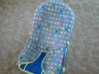 Blue bouncy seat with sun pattern. Good condition from
