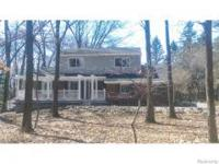 Tucked In Back Of A Fully Treed Front Yard Situated On