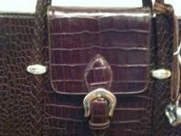 This purse is in excellent condition. It is a brown and