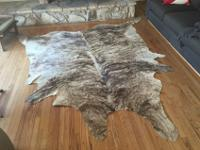 Selling my beautiful brindle cowhide rug.Looks amazing
