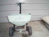 Walk behind broadcast spreader. $25. Call  or cell #