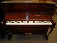 This is a sensational Broer upright piano. The case is