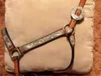 A beautiful leather show halter by Broken Horn. Has