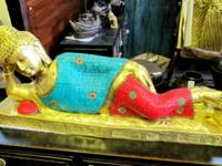This bronze reclining Buddha with blue turquoise and