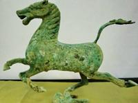 This replica cast bronze Warring State war horse in the