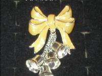 This Pin Brooch is an enamel yellow ribbon bow with 4