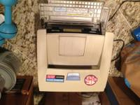 Small laser printer, comes with CD. Works well, gently