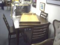 This is a USED 4 chair brown country style dinette set
