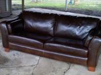 Selling a brown couch $50 Has a couple rips and scuffs.