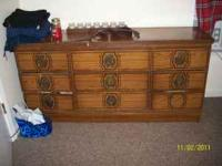 Dresser in decent shape. One handle missing. $35 OBO.