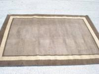 Good thick rug, clean, but has some burn marks on one