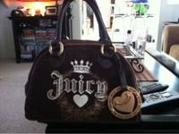 In great condition, brown and gold juicy handbag. Call