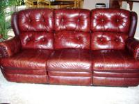Brrown leather couch with dual recliners in good