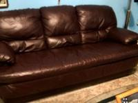 Genuine leather couch, very comfortable, has some
