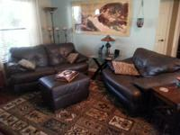 Brown leather love seat, chair and ottoman.  Good
