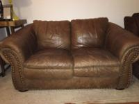 Gently used brown leather loveseat for sale. In great