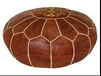 This is a beautiful brown leather round ottoman that