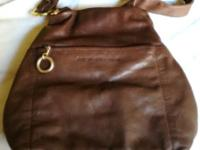 This is a high-quality brown leather handbag. Brand is
