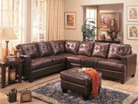 This smooth modern bonded leather sectional sofa will