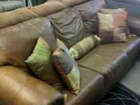 Brown/Rust leather couch, in great condition. Only