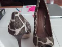 These are Brown with a 5 1/2 in giraffe pattern heel