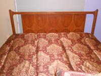Queen bed with metal frame. Belongs to my husband from