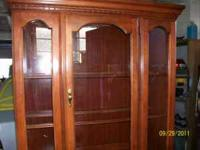 Very nice light to medium finish china cabinet by