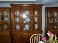 This is a beautiful preowned oak buffet and hutch by