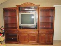 Broyhill solid wood four piece entertainment center.