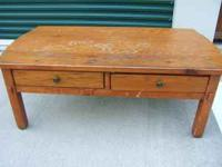 A Broyhill solid wood coffee table. Has two drawers.