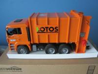 Bruder LOTOS rear loading toy garbage truck. Comes with