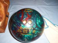 This is a good condition Brunsick aixs bowling ball and