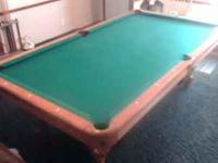 pool table is in great condition. comes with a rack and