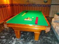 It's a 9 Ft. Brunswick Brookstone Pool Table / Color: