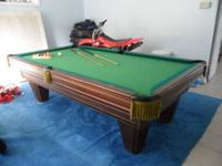 a Used Heritage by Brunswick Pool Table, 2 cue sticks,
