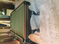 8ft Brunswick pool table and wall mount cue/ball