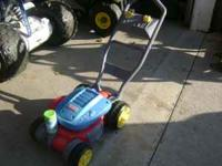 Bubble Mower that blows bubbles when you push it. Used