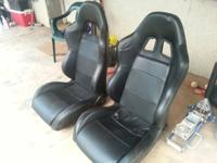 Selling a pair set of racing bucket seats black leather