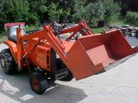 Light Bucket Tractor: This Jacobson tractor has been
