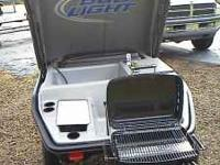 Brand new, never used. Cooler, cup holders, prep areas,
