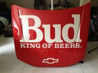 Full sized red NASCAR design automobile hood in