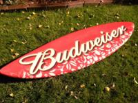 This is a decorative Budweiser beer wall-mountable bar
